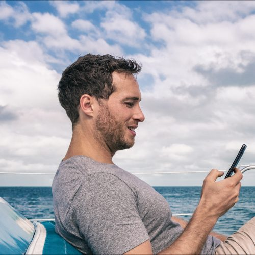 yacht tracking man with mobile device